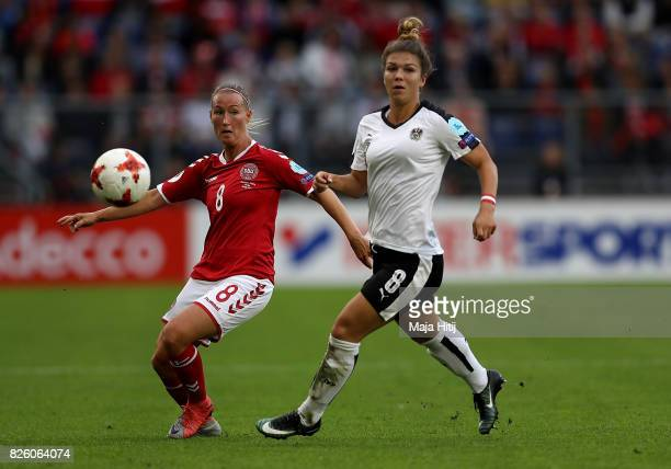 Theresa Nielsen of Denmark holds off pressure from Nadine Prohaska of Austria during the UEFA Women's Euro 2017 Semi Final match between Denmark and...