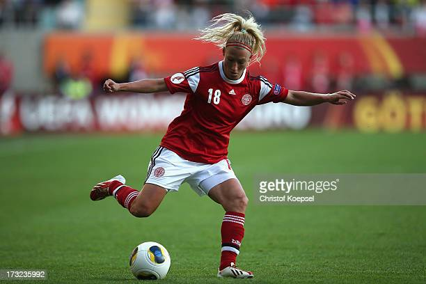 Theresa Nielsen of Denmark runs with the ball during the UEFA Women's EURO 2013 Group A match between Sweden and Denmark at Gamla Ullevi Stadium on...