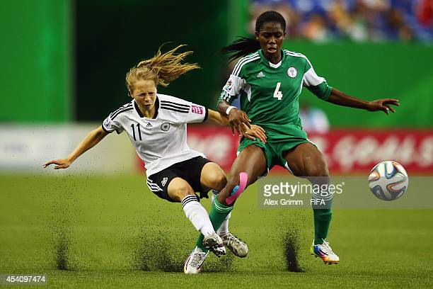 Theresa Panfil of Germany is challenged by Asisat Oshoala of Nigeria during the FIFA U20 Women's World Cup Canada 2014 final match between Nigeria...