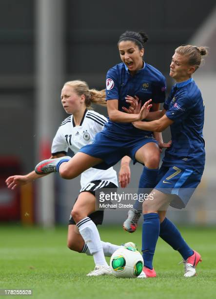 Theresa Panfil of Germany U19 women is squeezed out by Ghoutia Karchouni and Faustine Robert of France U19 women during the UEFA Women's U19 Semi-...