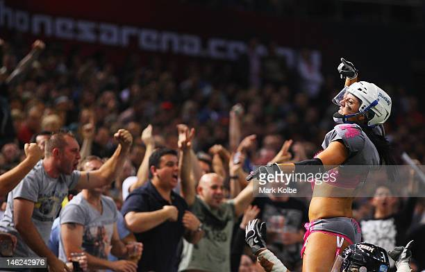 Theresa Petruziello of the Eastern Conference NSW Blues pumps up the crowd during game two of the AllStar Lingerie Football League tour at Allphones...