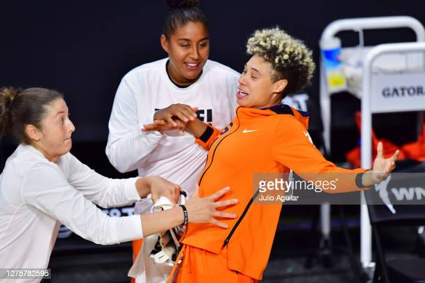 Theresa Plaisance Kaleena MosquedaLewis and Natisha Hiedeman of the Connecticut Sun react after DeWanna Bonner scored a three point basket during the...