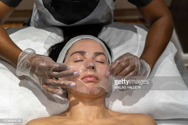 Theresa Shangazhike manager of the Spa Experience Wimbledon gives her client Lauren Shine a facial treatment in Wimbledon south London on August 15...