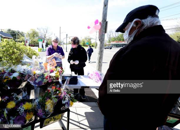 Theresa Soto and Elizabeth Mcginn work the cashier stand outside the Flowers by Voegler store on May 10 2020 in Merrick New York Theresa Soto is the...