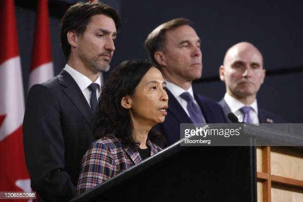 Theresa Tam Canada's chief public health officer left speaks while Justin Trudeau Canada's prime minister from left Bill Morneau Canada's finance...