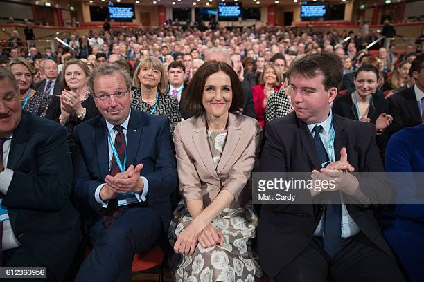 Theresa Villiers MP is applauded by a speaker on stage on the third day of the Conservative Party Conference 2016 at the ICC Birmingham on October 4...