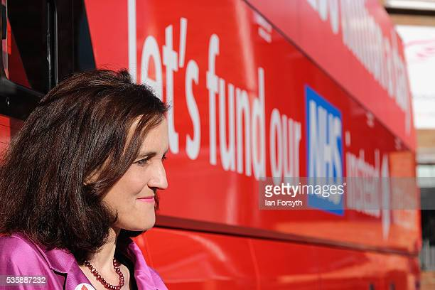 Theresa Villiers MP stands next to the battle bus as she waits for the arrival of Boris Johnson MP during a visit to ChesterLeStreet Cricket Club as...