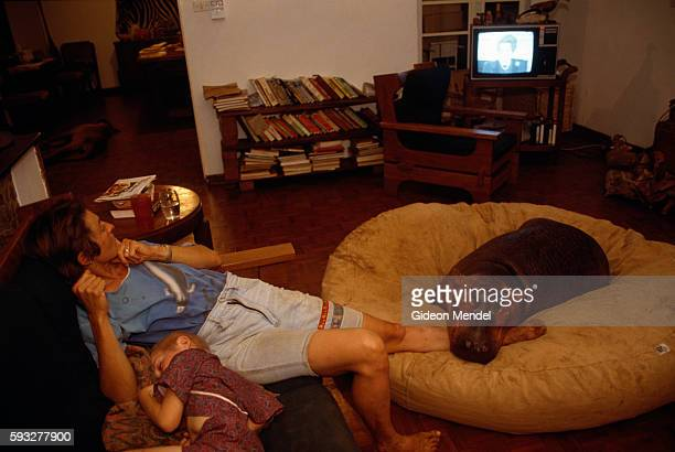 Theresa Warth watches TV along with Hippy the Hippo and her sick son Steven