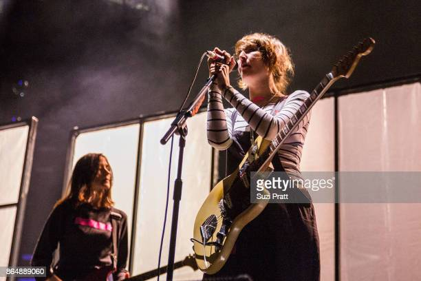 Theresa Wayman and Emily Kokal of Warpaint performs during the 'Global Spirit Tour' at KeyArena on October 21 2017 in Seattle Washington