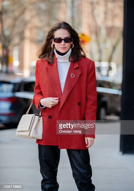Therese Hellström is seen wearing black leather pants knit red blazer outside Bevza during New York Fashion Week Fall / Winter on February 09 2020 in...