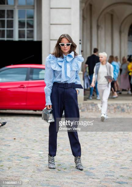 Therese Hellström is seen wearing blue ruffled blouse navy pants silver Boyy bag outside Lala Berlin during Copenhagen Fashion Week Spring/Summer...