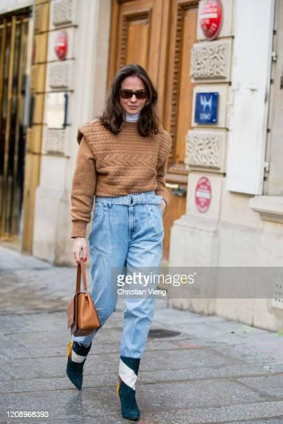 Therese Hellström is seen wearing brown knit, denim jeans, Caroline Herrera bag, ankle boots outside Guy Laroche during Paris Fashion Week -...