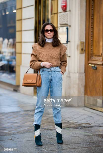 Therese Hellström is seen wearing brown knit denim jeans Caroline Herrera bag ankle boots outside Guy Laroche during Paris Fashion Week Womenswear...