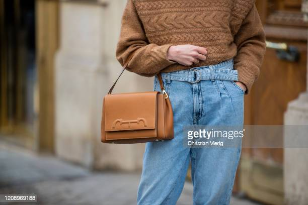 Therese Hellström is seen wearing brown knit denim jeans Caroline Herrera bag outside Guy Laroche during Paris Fashion Week Womenswear Fall/Winter...
