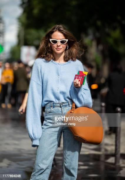 Therese Hellström seen wearing blue knit, denim jeans, brown bag outside Issey Miyake during Paris Fashion Week Womenswear Spring Summer 2020 on...