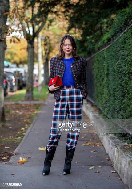 Therese Hellström seen wearing checkered pants jacket blue knit boots red bag outside Lacoste during Paris Fashion Week Womenswear Spring Summer 2020...