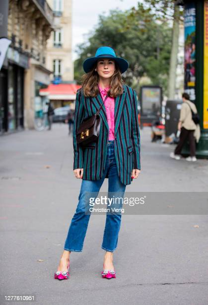 Therese Hellström seen wearing hat, striped blazer, brown bag, denim jeans, pink button shirt outside GAUCHERE during Paris Fashion Week - Womenswear...
