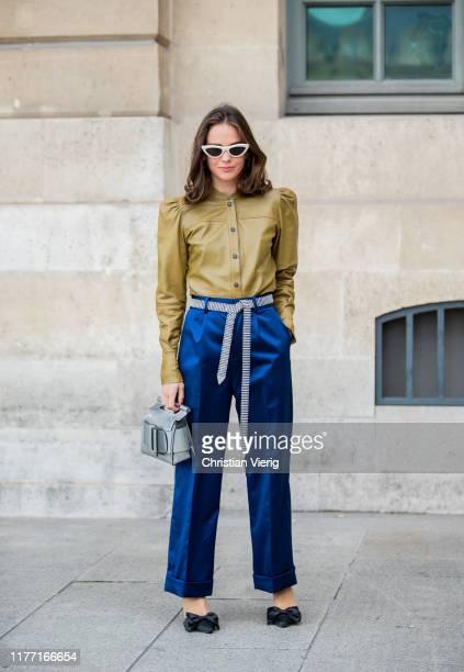 Therese Hellström seen wearing leather button shirt, navy pants, silver Boyy bag outside Guy Laroche during Paris Fashion Week Womenswear Spring...