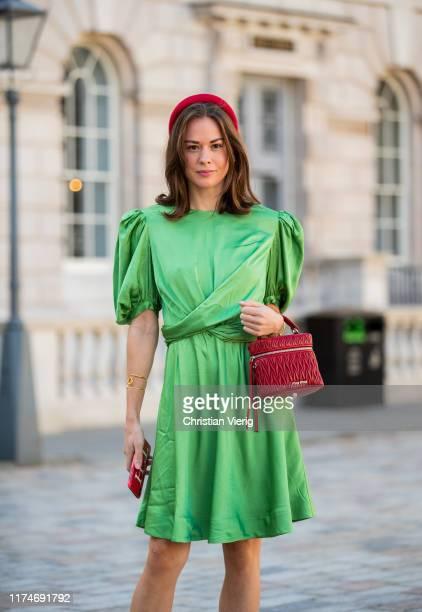 Therese Hellström seen wearing red hair loop, green silk skirt, red bag outside Fyodor Golan during London Fashion Week September 2019 on September...
