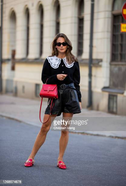 Therese Hellström wearing black cardigan with white collar red bag black shorts seen during Stockholm Fashion Week Digital Edition 2020 on August 25...