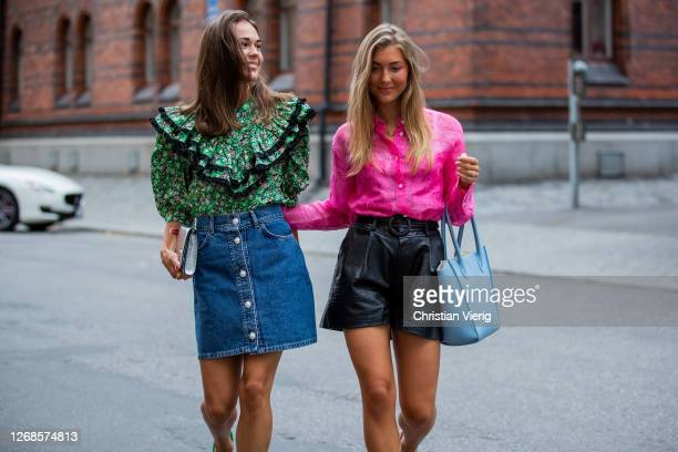 Therese Hellström wearing green ruffled blouse denim skirt clutch green heels and My Andrén wearing pink blouse black shorts blue bag heels seen...