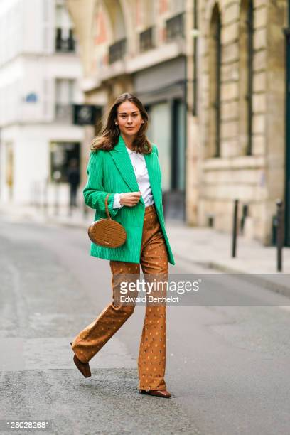 Therese Hellström wears a brown leather crocodile pattern bag from Cafune, an all Paul & Joe outfit made of an oversized corduroy green blazer...