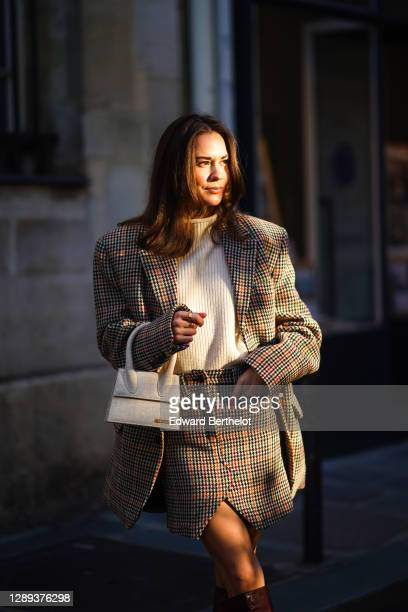Therese Hellström wears a full Zadig & Voltaire look made of a white wool pullover, a checked houndstooth pattern oversized blazer jacket with long...