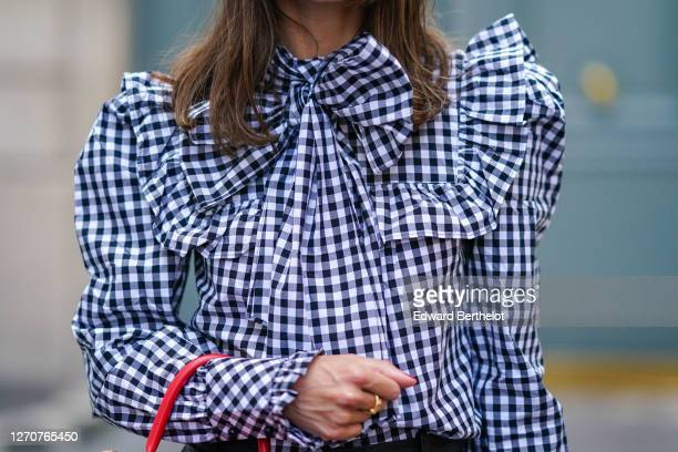 Therese Hellström wears a ruffled blue and white checkered blouse / shirt with bow tie from Custommade, on September 03, 2020 in Paris, France.