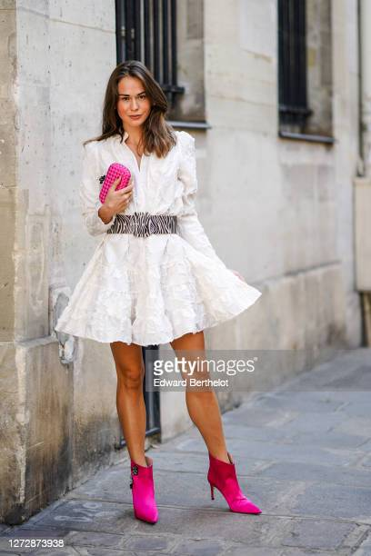 Therese Hellström wears a white gathered/pleated dress with embroidery and shoulder pads from H&M, a large black and white zebra print pattern belt,...