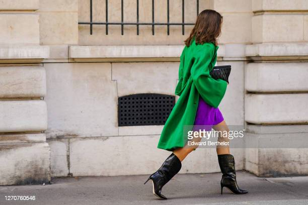 Therese Hellström wears black leather high heels pointy crocodile pattern boots from Custommade, purple shorts from Scotch & Soda, a white shirt /...