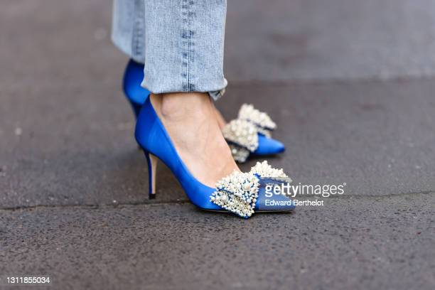 Therese Hellström wears blue denim jeans pants, blue high heels bejeweled pump pointed shoes, on April 08, 2021 in Paris, France.