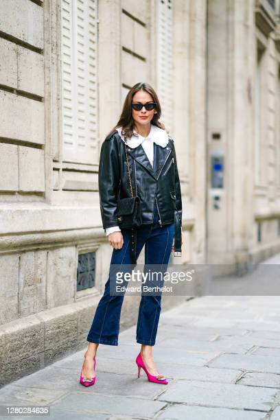 Therese Hellström wears sunglasses, a white shirt / blouse with ruffles from Paul & Joe, a black leather jacket from CBLOMST, a Chanel bag, blue...