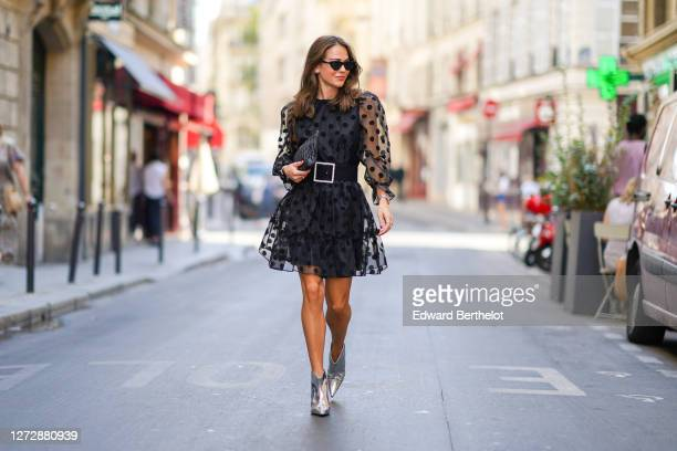Therese Hellström wears sunglasses from Chimi Eyewear, a black mesh pleated / ruffled black dress with printed polka dots from By Malina, a Miu Miu...