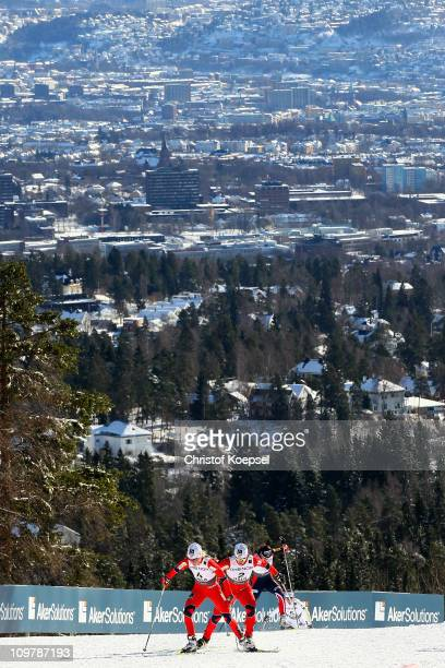 Therese Johaug and Marit Bjoergen of Norway compete in the Ladies Cross Country 30km Mass Start race during the FIS Nordic World Ski Championships at...