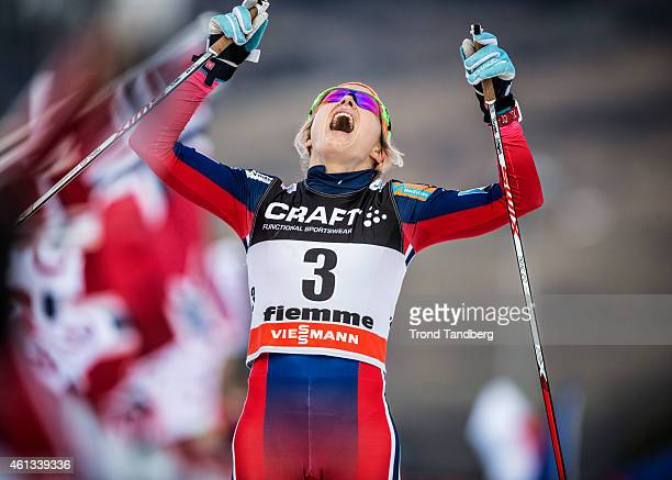 Therese Johaug of Norway celebrates 2nd place in the ladies 9 km Pursuit FreeFinal climb Alpe Cermis Tour de Ski on January 11 2015 in Val di Fiemme...