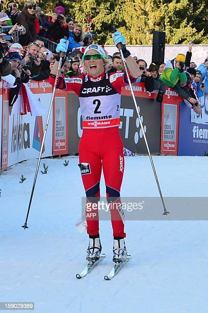 Therese Johaug of Norway celebrates after crossing the finish line second during the women's 9km free final climb pursuit of the Tour de Ski in Val...