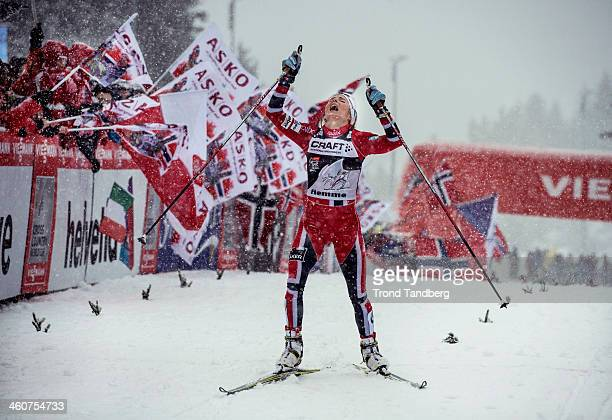 Therese Johaug of Norway celebrates after taking 1st place on day 7 of the FIS CrossCountry World Cup Tour de Ski during the Women's 5km Classic on...