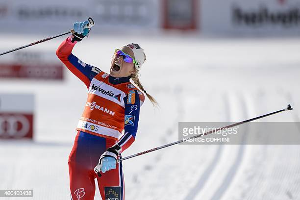 Therese Johaug of Norway celebrates after winning in the women's 10km classic individual race at the Nordic skiing FIS CrossCountry World Cup in...