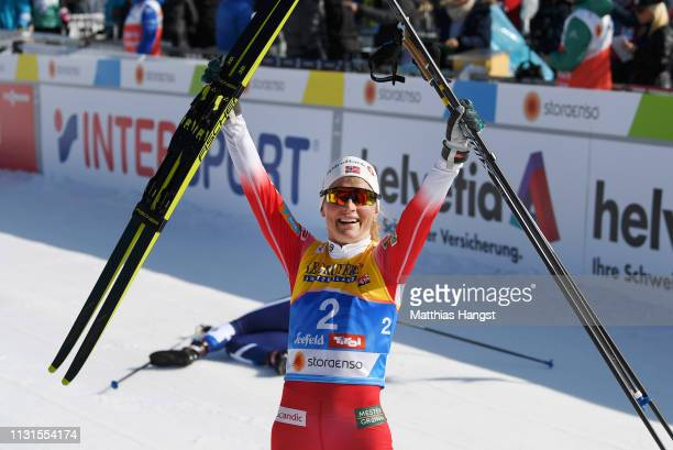 Therese Johaug of Norway celebrates after winning the Cross Country Skiathlon Ladies 15k race during FIS Nordic World Ski Championships on February...