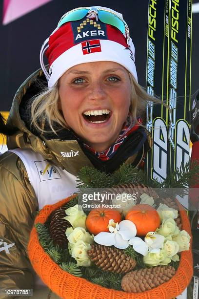 Therese Johaug of Norway celebrates after winning the gold medal in the Ladies Cross Country 30km Mass Start race during the FIS Nordic World Ski...
