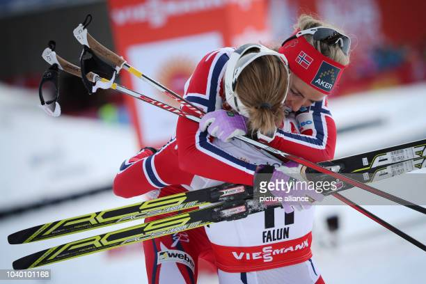 Therese Johaug of Norway celebrates after winning the women's cross country 75km classic 75km freestyle skiathlon race at the Nordic skiing world...