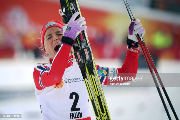 Therese Johaug of Norway celebrates after winning the women's Cross Country 75km Classic 75km Free Skiathlon race at the Nordic Skiing World...