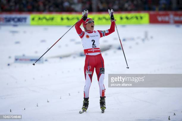 Therese Johaug of Norway celebrates before crossing the finish line to win the women's Cross Country 75km Classic 75km Free Skiathlon race at the...