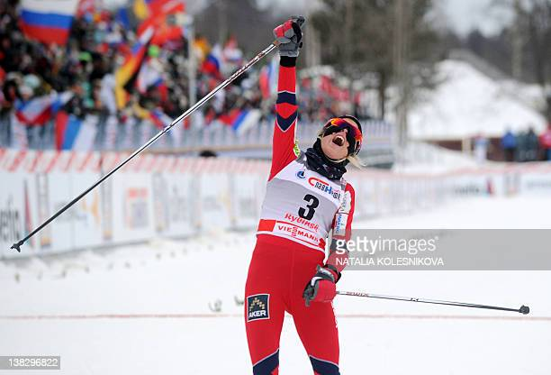Therese Johaug of Norway celebrates her victory at the FIS World Cup Crosscountry women's Skiathlon 75 km Classic 75 km freestyle competition in...