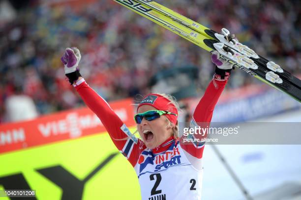 Therese Johaug of Norway celebrates in the finish during the cross country Ladies 30 Kilometers Mass Start Classic competition at the Nordic Skiing...