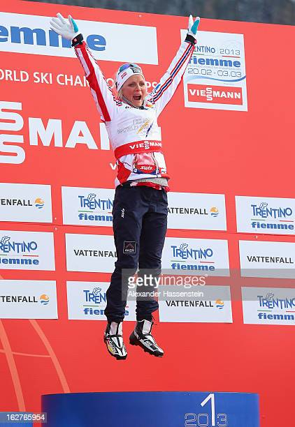 Therese Johaug of Norway celebrates victory in the Women's Cross Country Individual 10km at the FIS Nordic World Ski Championships on February 26,...