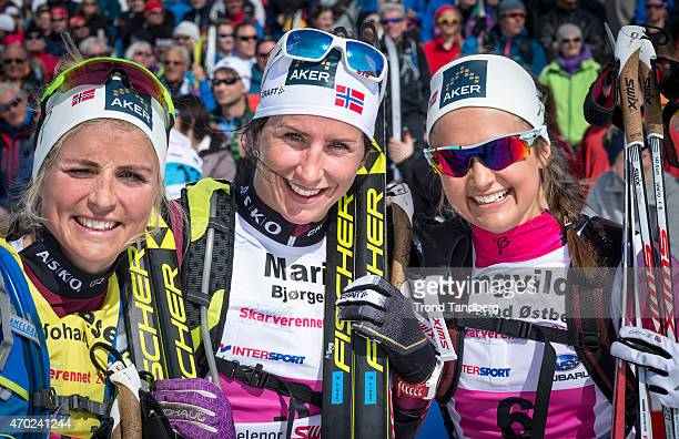 Therese Johaug of Norway celebrates victory with Marit Bjoergen of Norway and Ingvild Fluegstad Ostberg of Norway Skarverennet on April 18 2015 in...