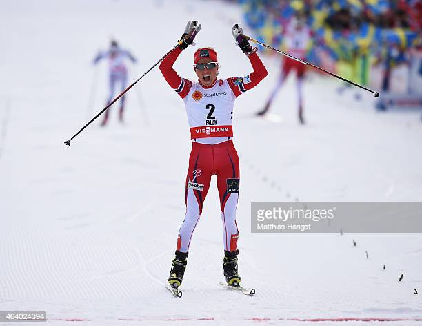 Therese Johaug of Norway celebrates winning the gold medal in the Women's 15km CrossCountry Skiathlon during the FIS Nordic World Ski Championships...