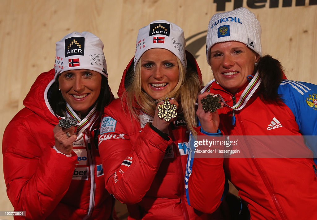 Therese Johaug of Norway celebrates with her Gold medal, Marit Bjoergen of Norway (l) her Silver medal and Yulia Chekaleva of Russia (r) her Bronze medal, at the medal ceremony for the Women's Cross Country Individual 10km at the FIS Nordic World Ski Championships on February 26, 2013 in Val di Fiemme, Italy.