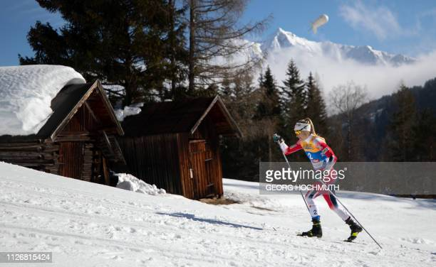 Therese Johaug of Norway competes in the Women's 15km crosscountry skiathlon event at the FIS Nordic Combined World ski Championships on February 23...